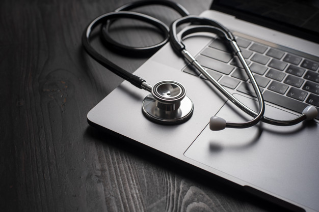 Close-up Of Medical Stethoscope On Laptop Keyboard